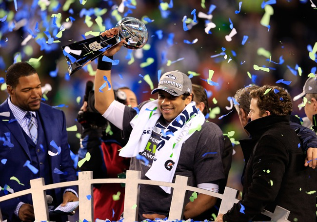 Seattle Seahawks Russell Willson lifts Superbowl Trophy with Confetti