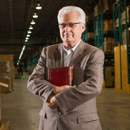 David Green, Hobby Lobby CEO, David Green with Bible in warehouse, Culture Wars, Abortifacients, Obamacare, Affordable Care Act